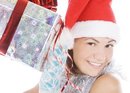 Santa woman showing gift wearing Santa hat. photo
