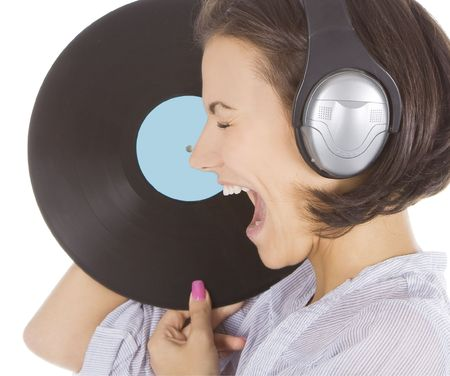 Profile of emotional brunette in headphones with vinyl record over white photo