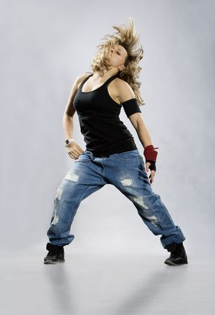 Teenage girl dancing breakdance in action  photo