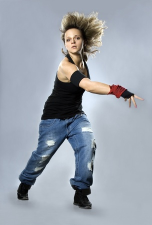 Teenage girl dancing breakdance in action photo