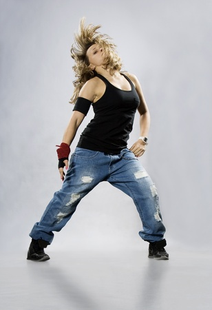 Teenage girl dancing breakdance in action