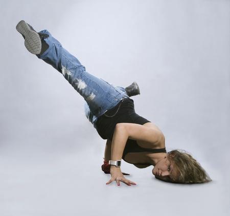 Teenage girl dancing breakdance in action Stock Photo - 8561627