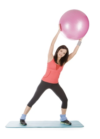 Attractive young female with fitness ball in stretching Stock Photo - 8732318