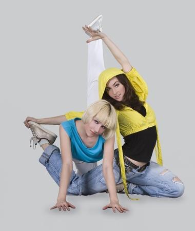 Teenager girls dancing breakdance in action photo