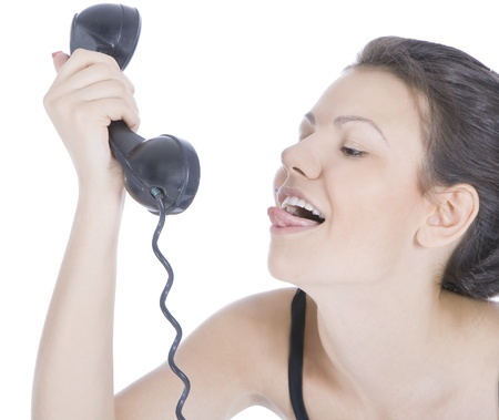 Bright picture of fun brunette showing tongue to phone Stock Photo - 8852220