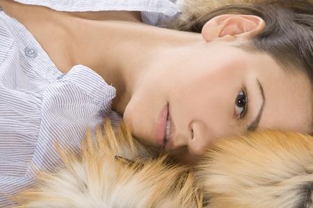 beautiful young woman lying in a fur Stock Photo - 8852239