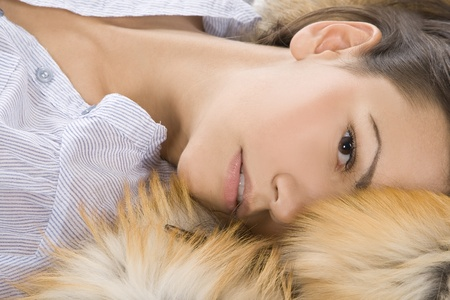 beautiful young woman lying in a fur Stock Photo - 8852239