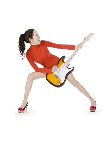 Sexy young female posing with guitar over white Stock Photo - 8939404