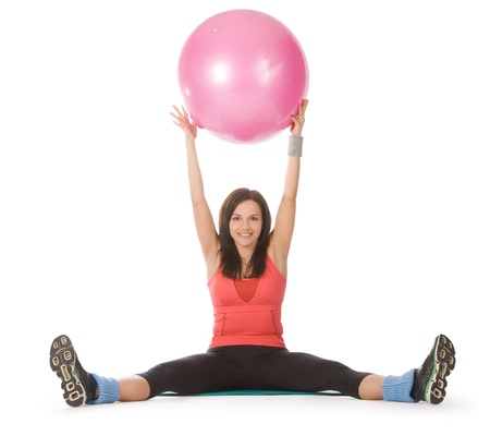 Attractive young female with fitness ball in stretching photo
