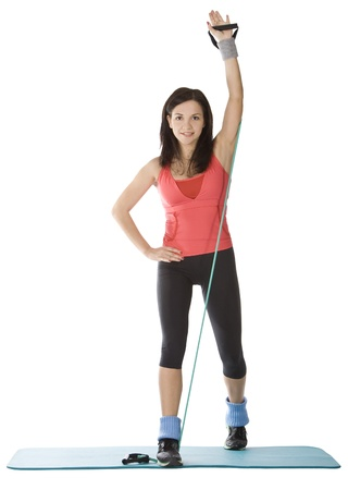 expander: Attractive young female with fitness expander in stretching