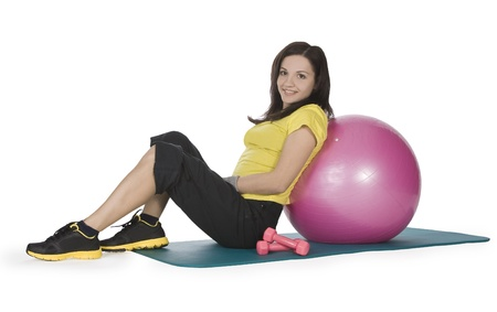 Attractive young female with fitness dumbbells and ball Stock Photo - 9011431
