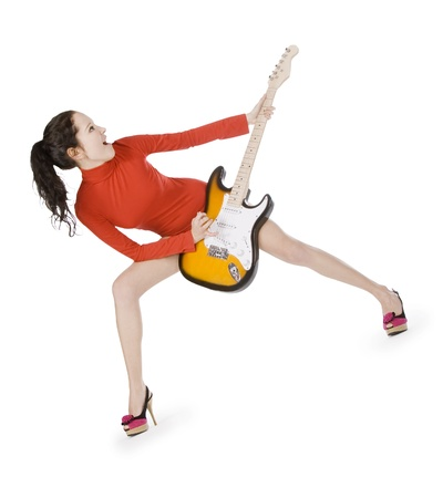 Sexy young female posing with guitar over white photo