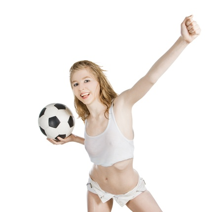 Young caucasian female with soccer ball on white background photo