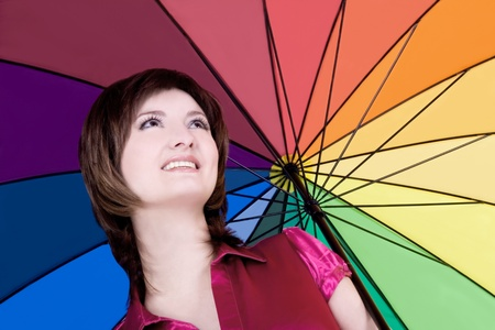 Beautiful woman with colorful umbrella photo