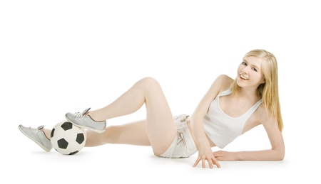 Bright picture of sexy woman with soccer ball over white photo