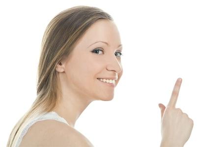 魅力的な女性は彼女の指を指すの明るい絵 写真素材