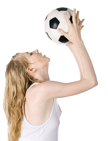 Bright picture of young blonde with soccer ball photo