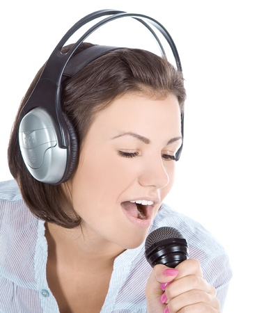 Caucasian female singing into microphone. photo