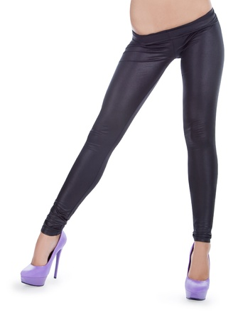 Attractive female wearing in a black leggings posing over white Stock Photo - 9470661