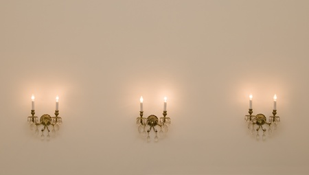 Interior of vintage room with three antique wall lamps. photo
