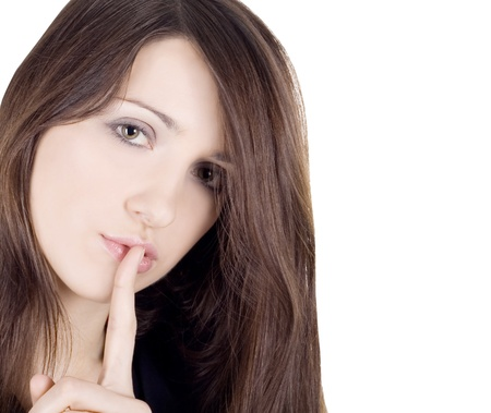 bright picture of young woman with finger on lips over white photo