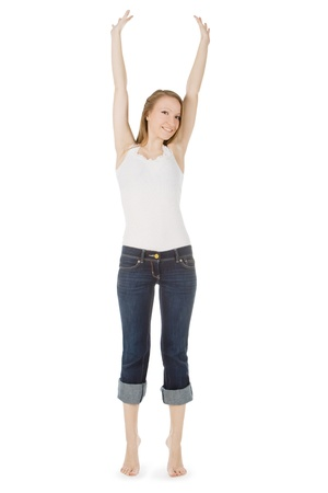 bright picture of happy and carefree teenage girl in jeans over white photo