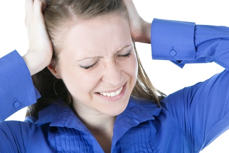 and anxiety: woman with headache holding her hands to the head Stock Photo