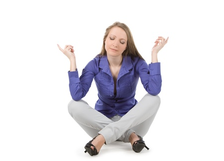 power of thinking: young happy woman sitting against white background