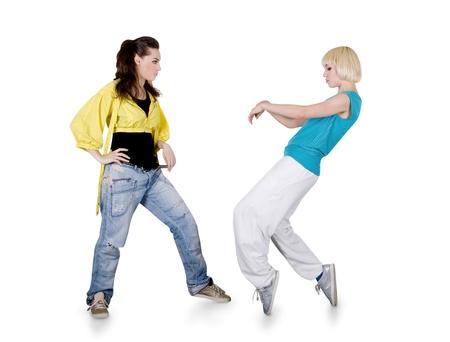 Ni�as adolescente bailando hip-hop sobre fondo blanco Foto de archivo - 9727502
