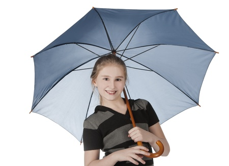 Young blonde girl standing and holding blue umbrella photo