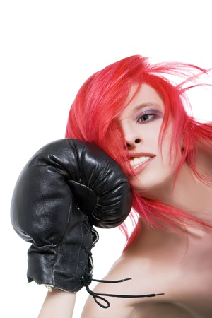 Red-hair girl receives a knockout blow in the face of boxing gloves photo