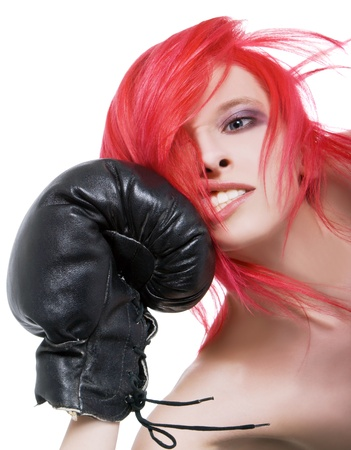 girl punch: Red-hair girl receives a knockout blow in the face of boxing gloves