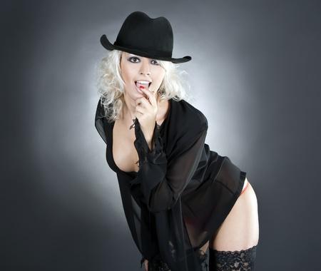 blonde fashion woman portrait wearing black hat over dark photo