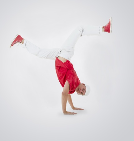 Teenager dancing breakdance in action photo