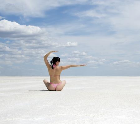 Beautiful young woman doing yoga exercise outdoors Stock Photo - 10103314