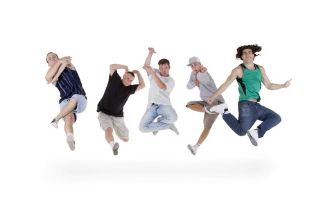 Group of young teenagers jumping over white Stock Photo - 10197288