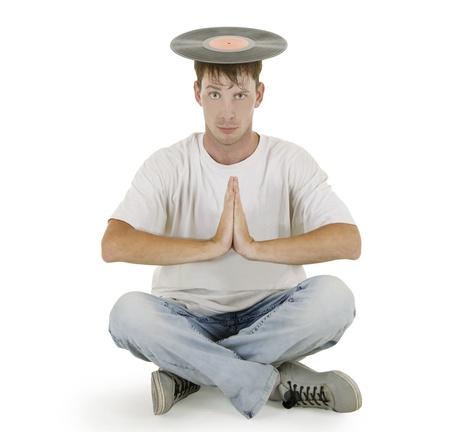 remix: DJ sitting on the floor with vinyl on his head