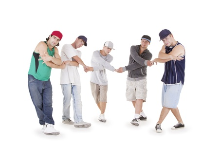 Group of young teenagers posing over white photo