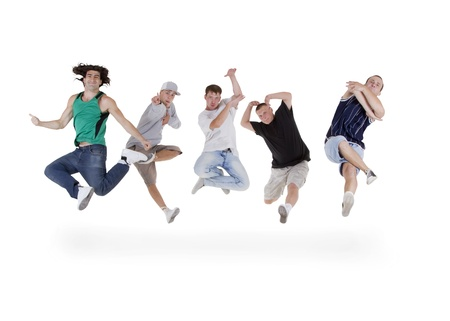 Group of young teenagers jumping over white photo