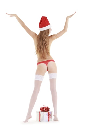 Wonderful female in santa hat and white stockings with christmas gift Stock Photo - 10787810