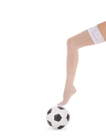 woman leg in white stockings on the soccer ball photo