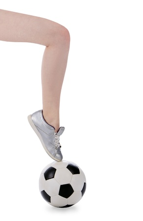 sexual activities: female foot in shoe is on the soccer ball