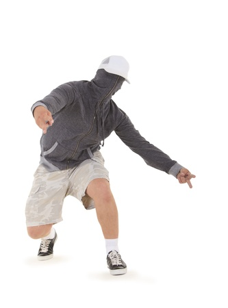 Teenager dancing breakdance in hood  photo
