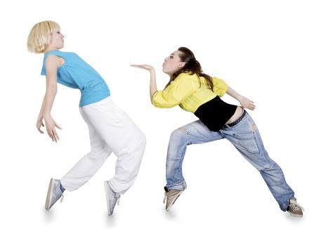 10 代の少女白い背景の上のヒップホップのダンス