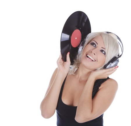 emotional blonde in headphones with vinyl record over white photo