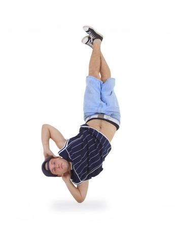young male dancer performing a bboying stunt photo