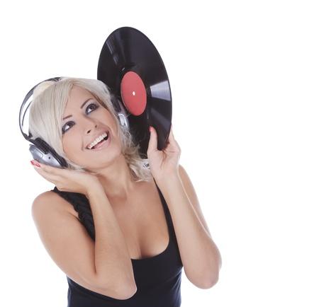 rubio emocional en auriculares con disco de vinilo de más de blanco