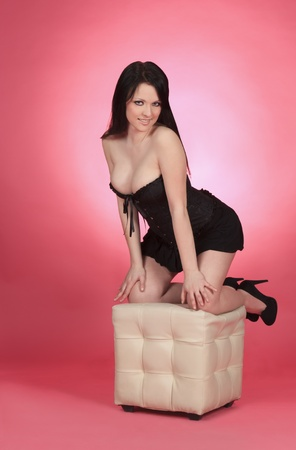 Sexy woman sitting on the chair