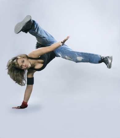 hip hop dancer: Teenage girl dancing breakdance in action Stock Photo