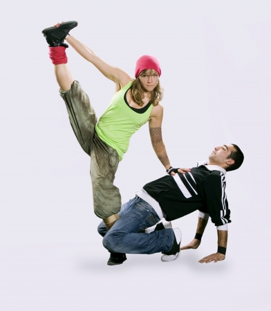 Teenagers dancing breakdance in action photo